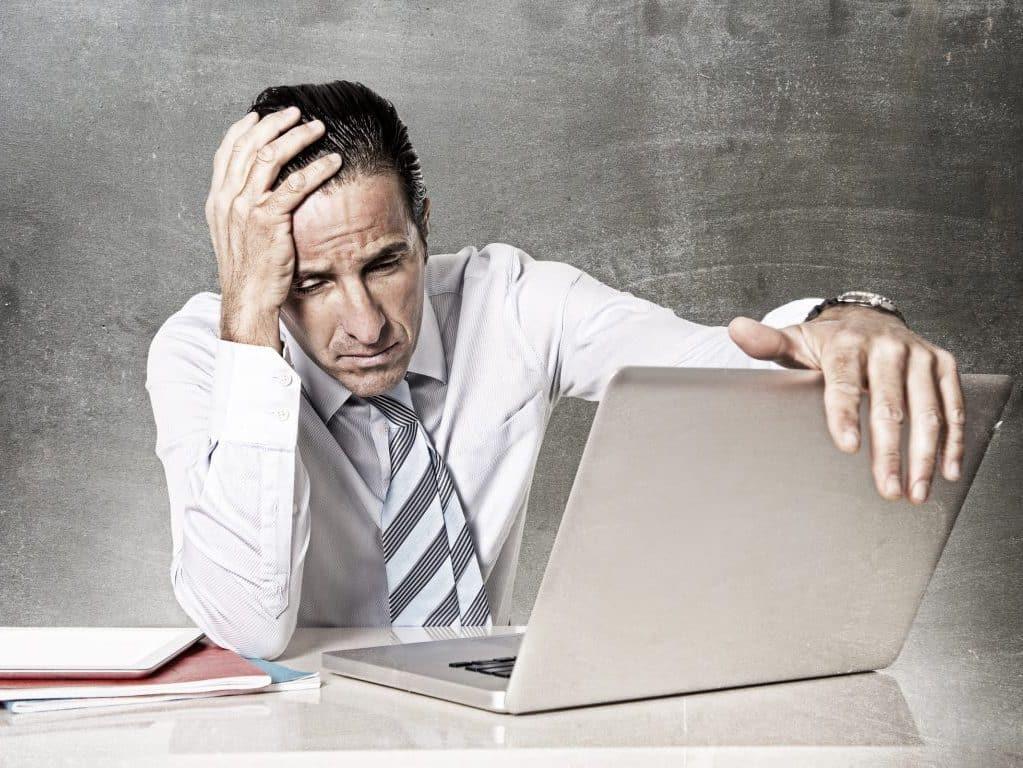 desperate senior businessman in crisis working office computer