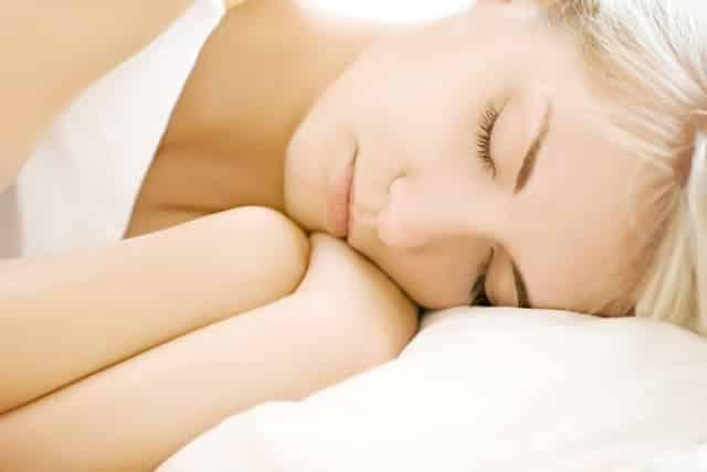 Portrait of a beautiful sleeping woman (shallow DoF, focus on eyes)